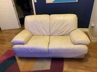 Two-seater cream leather sofa
