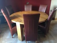 5ft 4 solid oak round table and 6 red leather chairs