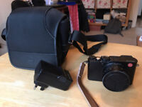 Leica D-Lux Typ 109 compact camera plus Leica camera bag and flashgun, and charger