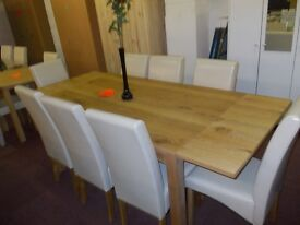 Brand new solid wood extending dining table +8 cream skirted chairs