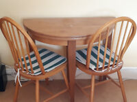 """Circular folding table with 2 chairs. It is """"half moon"""" when folded. £30 or nearest"""