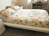 Nolte white bedframe without mattress and one side cabinet