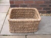 A heavy duty wicker log basket.