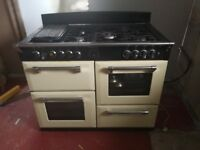 Used but still working gas range cooker, electric slow cooker.