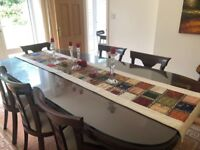 Beautiful solid dining table with 8 chairs