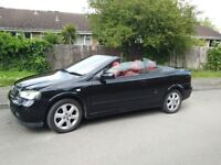 Black Vauxhall Astra Bertone 1.6 Convertible.