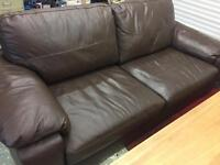 Nearly new brown leather couch