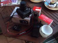 Canon 7D + battery extension + Canon Flash + diffuser