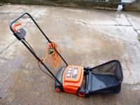 BLACK AND DECKER LAWN RAKE. ONLY USED 3 TIMES.