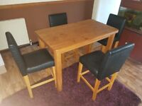 Solid wood table and leathet chairs
