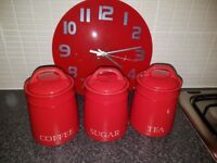 Red kitchen items, clock, storage jars, dish drainer