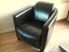 two dark brown leather / faux armchairs
