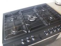 IKEA DUEL FUEL RANGE COOKER. 5 GAS RINGS; FAN ASSIST LARGE OVEN. BLACK and STAINLESS STEEL FINISH.