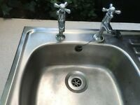 Sink and drainer with taps