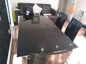 Matching black glass dining table,coffee table and 4 chairs.