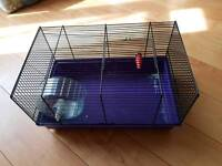 Small hamster house with wheel.