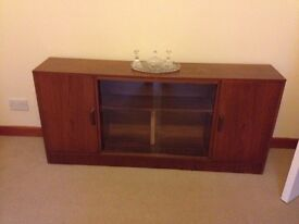 Low rise unit with glass display area and two cupboards. Selling cheaply.
