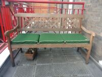 Wooden bench (Robert Dyas) with cushion needs a new home