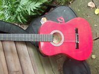 RED ACOUSTIC GUITAR EXCELLENT CONDITION WITH CASE.