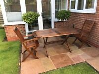Wooden Garden Table and 8 Chairs, with removable purple seat cushions good condition