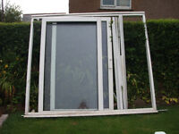UPVC framed patio doors. No longer working but the glass is in good condition.