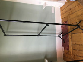 Two free-standing double clothes rails