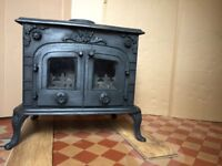 Magnificient Wood Burning Cast Iron Stove, with room for large logs