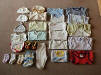 big bundle of baby clothes 0-3, 3-6, 6-9 months