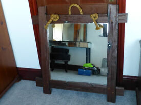 Large mirror in a distressed wooden frame