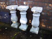 Concrete pillars suitable as pot stands.
