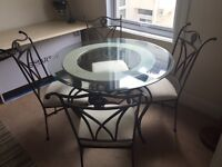 Dining Table with four Matching Chairs - Wrought Iron/Round Glass Top.