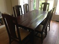 """""""Lom Bok"""" Teak Dining Table and 8 matching teak dining chairs with cream seats."""