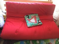 Argos Red Sofa Bed alongside IKEA LACK coffee table and magazine rack