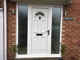 Front door with glass side panels