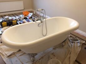 Roll top bath and mixer taps with shower