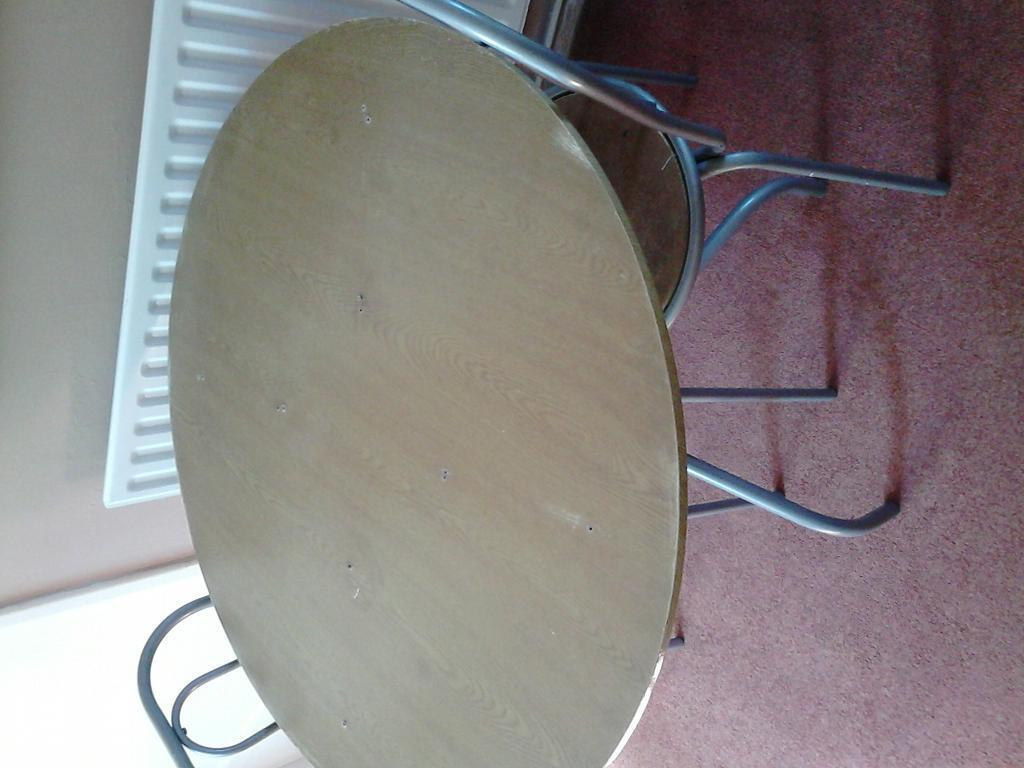 table and chairs and a cabinetin Crystal Palace, LondonGumtree - I am chucking this out as Im getting a new table and chairs and a smaller version the table has screw holes in it would suit a handy person who can work on it I also am throwing out a small two door cabinet but any one can collect asap