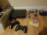 Playstation 3, 2 Controllers, 39 Games, Skylanders Supercharged with 7 Characters.