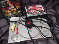 Playstation 1 console with 2 games