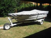 13 foot aluminum boat, 15hp motor, and trailer