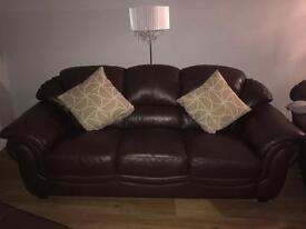 Three piece brown leather suite