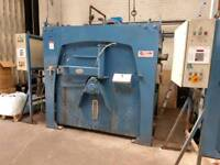 Milnor washing extractor and ironer commercial laundry equipment