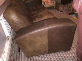 Large cigar brown leather sofa