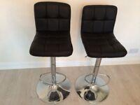 2 black high bar stools