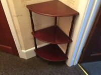 Mahogany corner table. Three shelves in excellent condition.