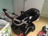 Mothercare Roam pushchair and travel system in black