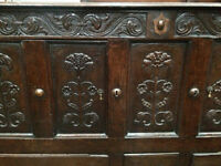 Traditional solid wood sideboard with intricate front and drawers, dark wood