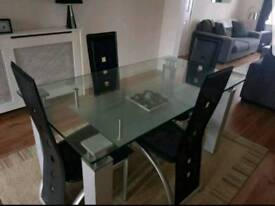 Glass table and 4 faux leather chairs