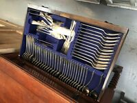 Edwardian canteen of walker and hall cutlery in cabinet