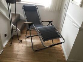 Pair of Zero gravity reclining chairs. Unused