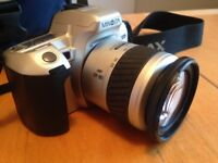 Minolta 404si Dynax film camera with zoom lens and Lowepro camera bag